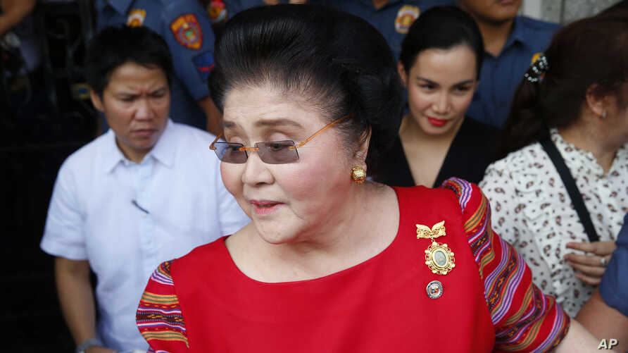 FILE - Former Philippines first lady, Congresswoman Imelda Marcos arrives at the Commission on Elections to support her daughter, Gov. Imee Marcos in filing for the May 2019 midterm elections in Manila, Philippines.