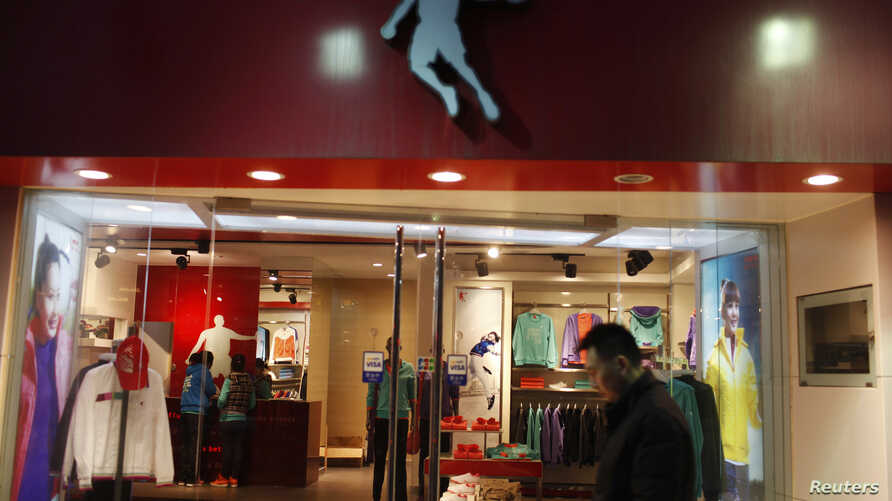 A man walks past a Qiaodan sports store in downtown Shanghai  in 2012. Michael Jordan sued Qiaodan, accusing the firm of unauthorized use of his name.