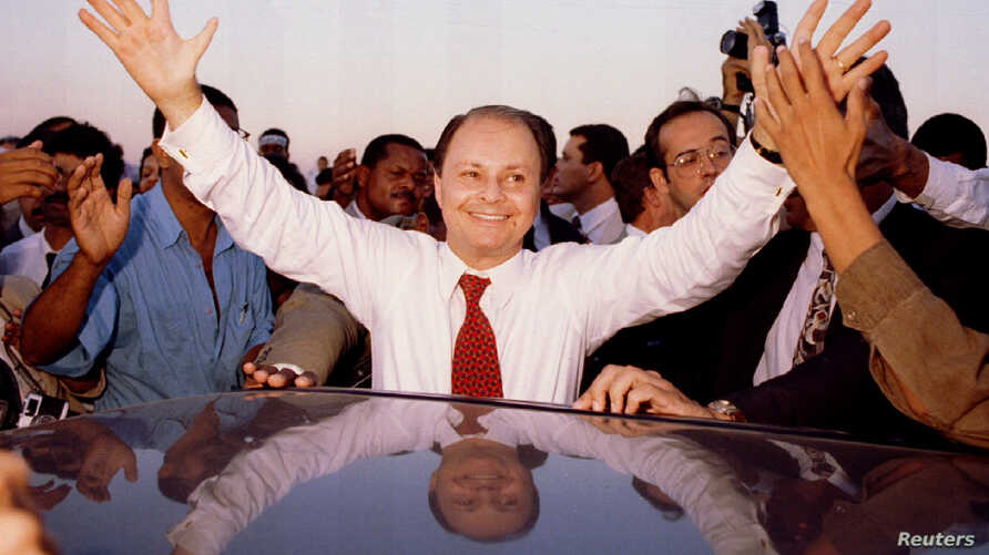 FILE - Edir Macedo, leader of Brazil's Universal Kingdom of God Church, greets worshippers of his powerful evangelical institution in 1995.