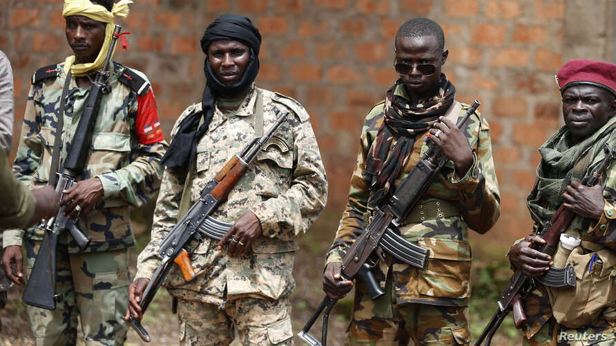 Seleka fighters warily eye a photographer at their base in Bambari, Central African Republic, on May 31, 2014.