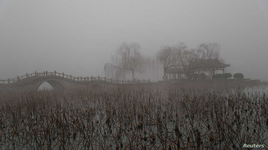 FILE - Heavy smog is seen during a polluted day at the Daming Lake in Jinan, Shandong province, China, Jan. 5, 2017.