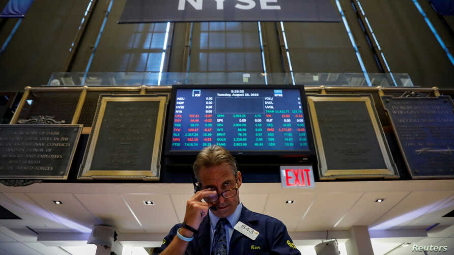 A trader works on the floor of the New York Stock Exchange (NYSE) in New York, Aug. 28, 2018.