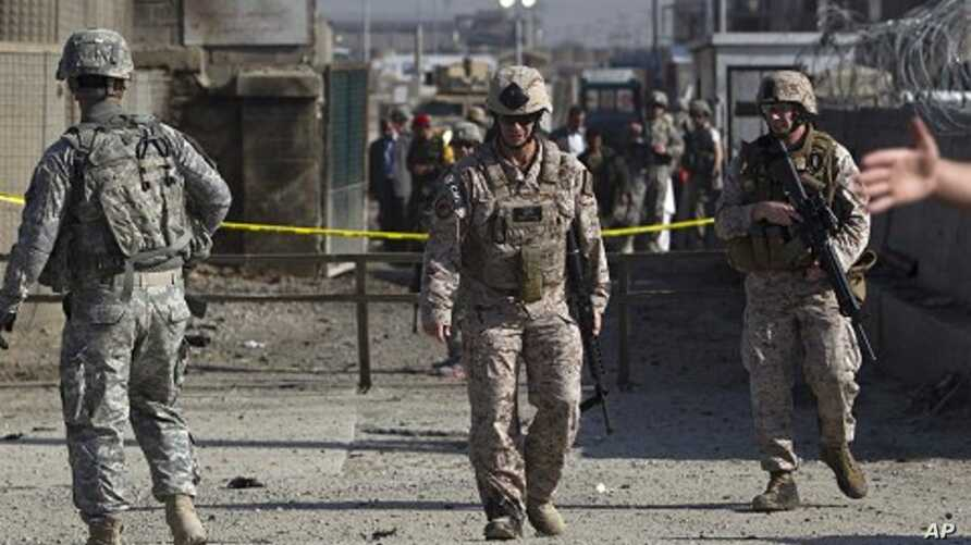 US soldiers keep watch after an attack at Camp Phoenix in Kabul, Afghanistan, April 2, 2011