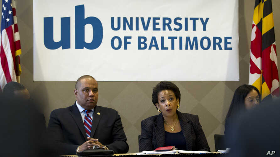 Attorney General Loretta Lynch speaks with members of Congress and faith leaders at the University of Baltimore on May 5, 2015, in Baltimore.