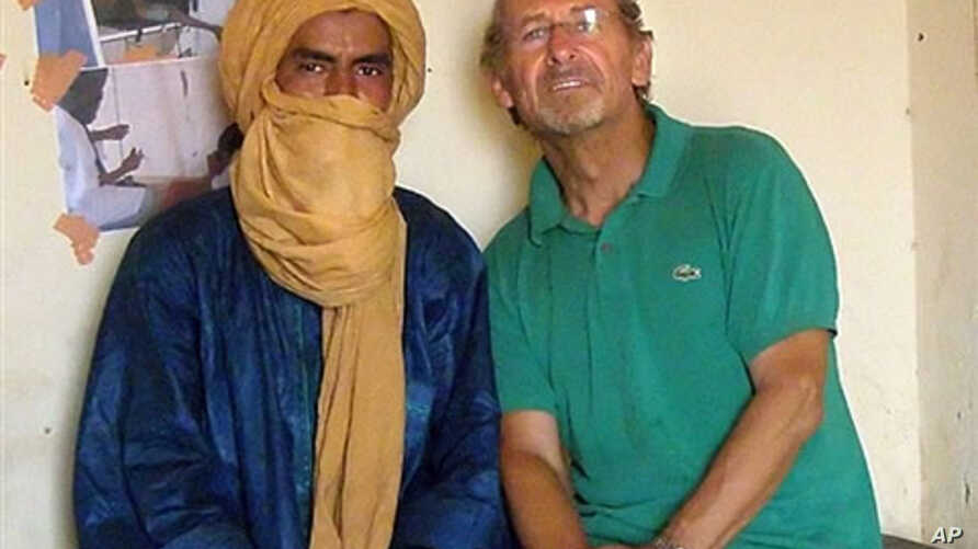 Undated handout photo with unknown dateline supplied by the Gerardmer-Tidarmene association shows Pierre Camatte (R), 61, posing with an unidentified man. Camatte was kidnapped overnight on 25 Nov 2009 in Menaka, northern Mali.