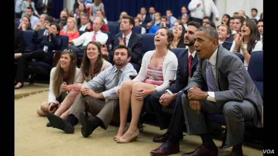 President Barack Obama and staff watch the U.S. soccer team vs Belgium in World Cup action in the Eisenhower Executive Office Building South Court Auditorium, July 1, 2014. (Official White House Photo by Pete Souza)