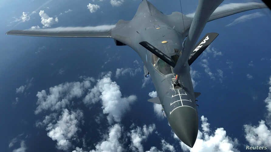FILE - One of two U.S. Air Force B-1B Lancer bombers is refueled during a 10-hour mission flying to the vicinity of Kyushu, Japan, the East China Sea, and the Korean peninsula, over the Pacific Ocean, Aug. 8, 2017.