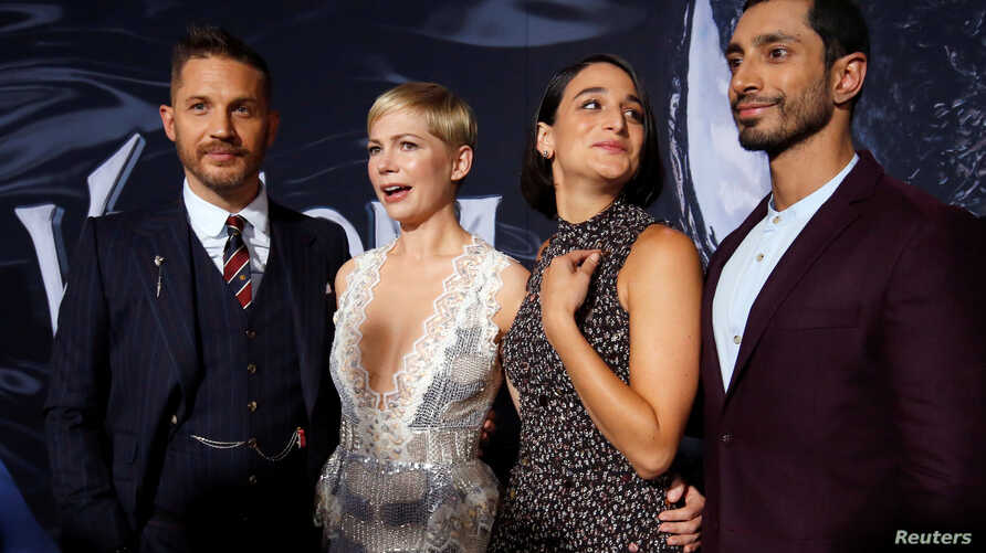 "Cast members, from left, Tom Hardy, Michelle Williams, Jenny Slate and Riz Ahmed attend the premiere for the movie ""Venom"" in Los Angeles, Oct. 1, 2018."