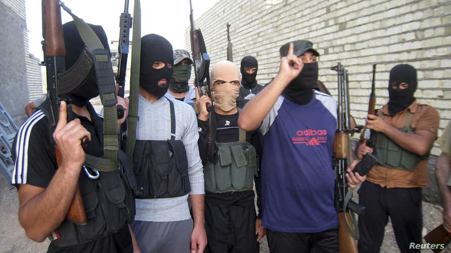 Earlier this year Islamic State militants seized a dam in Fallujah, flooding farmland on the outskirts of Baghdad and draining offshoots of the Euphrates River. Masked Sunni gunmen pose during a patrol outside Fallujah, Iraq, April 28, 2014.