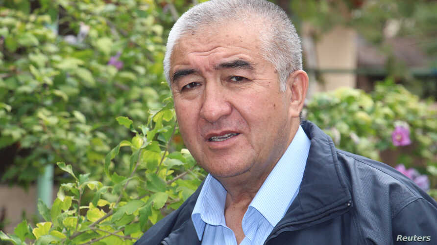 Uzbek dissident writer Nurulloh Muhammad Raufkhon, who was released by police on Sunday from exile on charges of spreading anti-government propaganda, is seen in the courtyard of his house in Tashkent, Uzbekistan, Oct. 2, 2017.