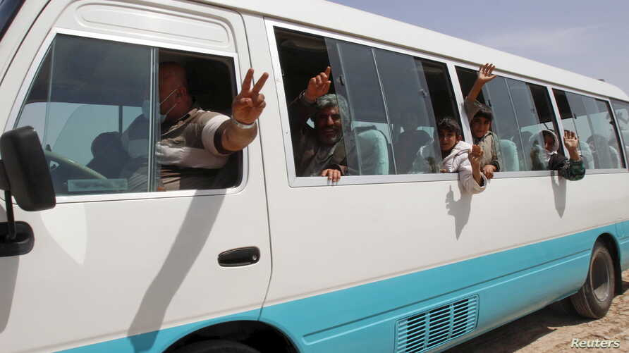 Members of the Yazidi minority sect who were newly released are seen in a vehicle on the outskirts of Kirkuk, April 8, 2015.