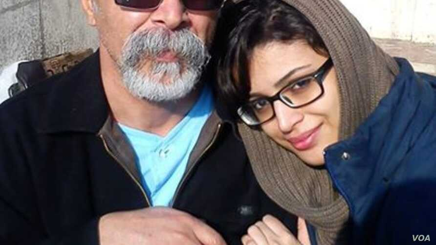 Sepideh Moradi, an Iranian Gonabadi Dervish woman detained at Qarchak prison since February, appears in this undated photo with her father.