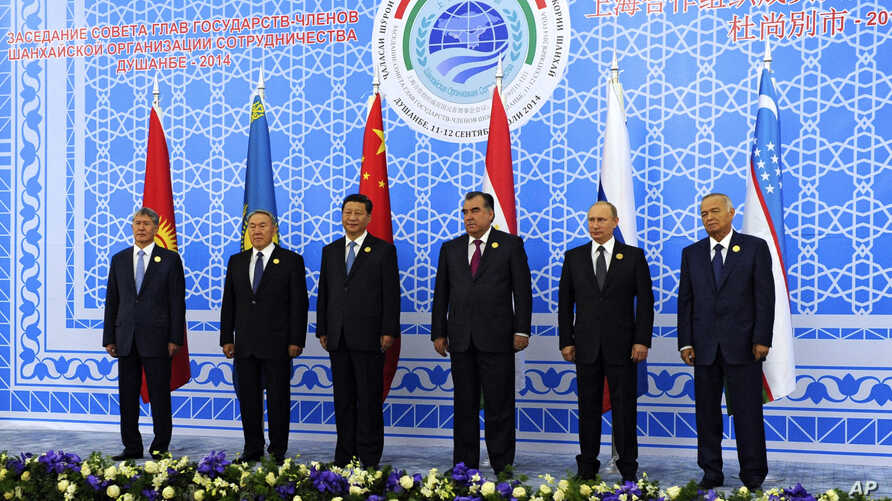 FILE - Leaders of the Shanghai Cooperation Organization pose for a photo during the group's summit in Dushanbe, Tajikistan, Sept. 12, 2014.