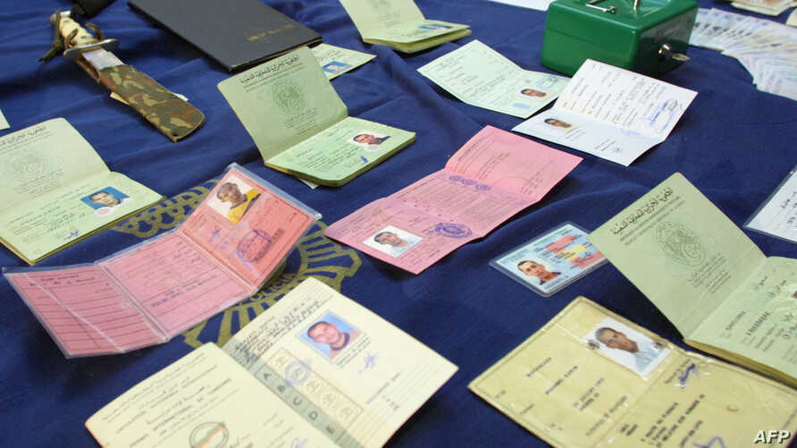 FILE - A knife and false ID cards, passports and driving licenses are part of the equipment seized and shown by police 27 September 2001 in Madrid, after six men were arrested in raids throughout Spain.