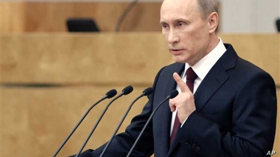 Russia's Prime Minister Vladimir Putin addresses the parliament in Moscow, April 20, 2011
