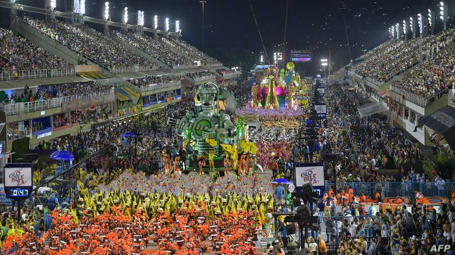 Members of the Sao Clemente samba school perform during the second night of Rio's Carnival parade at the Sambadrome in Rio de Janeiro, Brazil on March 4, 2019.