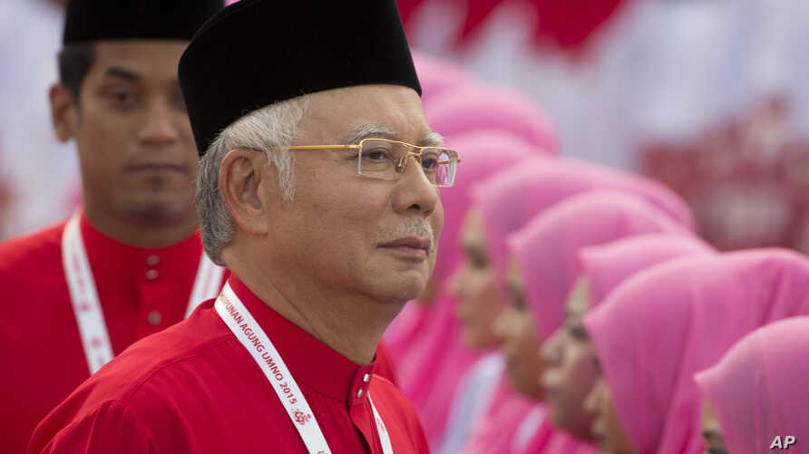 President of the ruling United Malays National Organisation (UMNO) and Malaysia's Prime Minister Najib Razak inspects a ceremonial guard of honor during the opening ceremony of the party's general assembly in Kuala Lumpur, Malaysia on Thursday, Dec.
