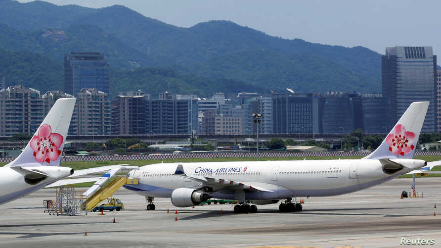 FILE - China Airlines airplanes are parked on the tarmac at Songshan Airport in Taipei, Taiwan, June 24, 2016.