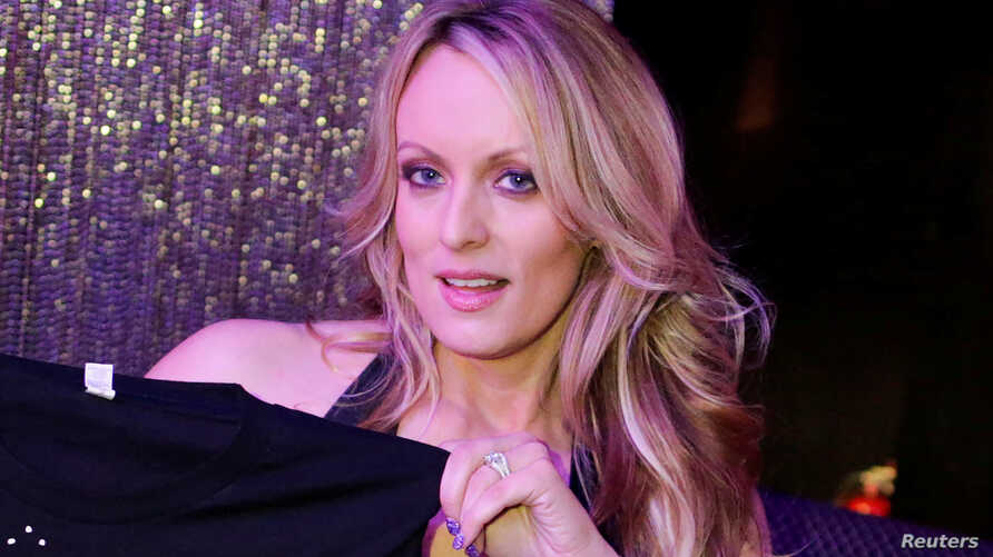 Adult-film actress Stephanie Clifford, also known as Stormy Daniels, poses for pictures at the end of her show at the Gossip  Club in Long Island, New York, Feb. 23, 2018.