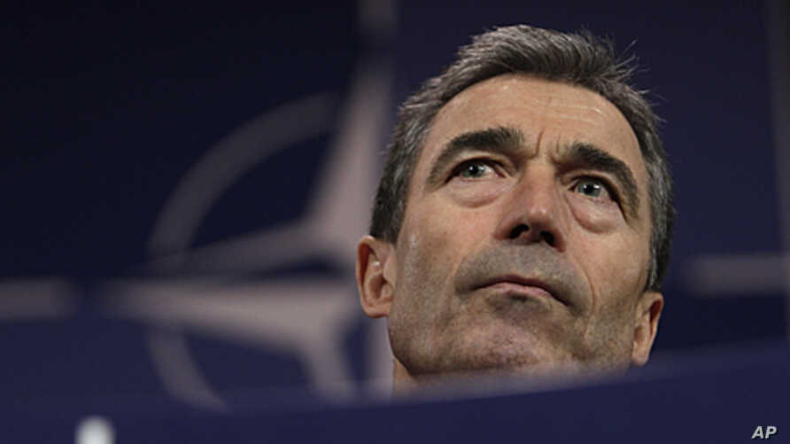 NATO Secretary-General Anders Fogh Rasmussen speaks during a media conference after a meeting of NATO defense ministers at NATO headquarters in Brussels, June 9, 2011.