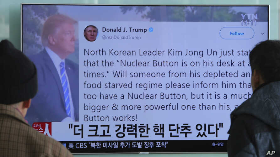 """People watch a TV news program showing the Twitter post of U.S. President Donald Trump  in Seoul, South Korea, Jan. 3, 2018. Trump boasted that he has a bigger and more powerful """"nuclear button"""" than North Korean leader Kim Jong Un."""