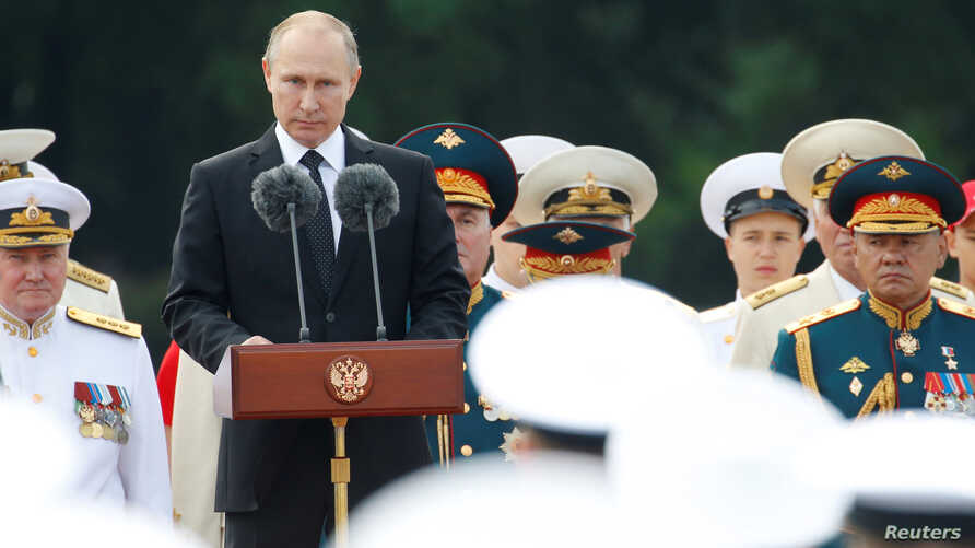 Russian President Vladimir Putin delivers a speech during the Navy Day parade in St. Petersburg, Russia, July 30, 2017.