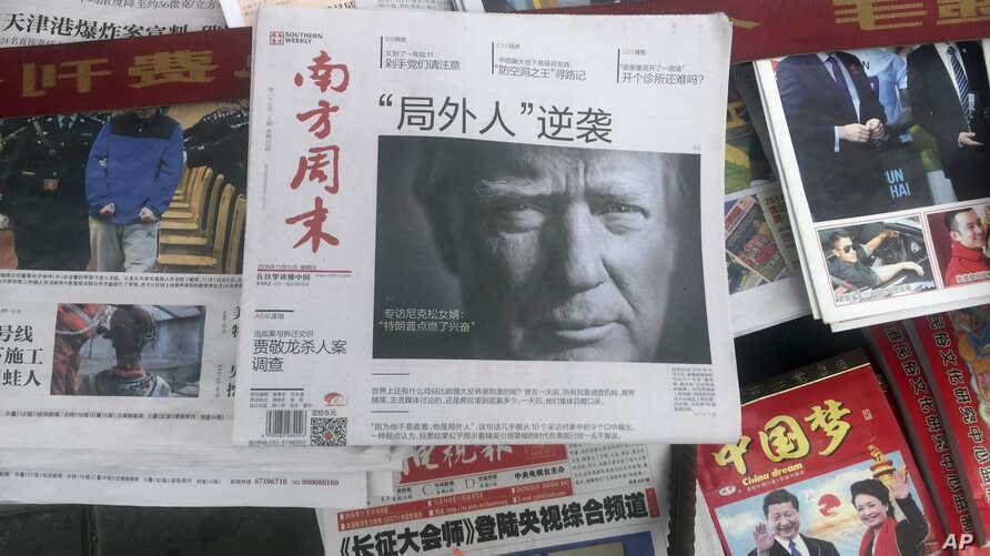 FILE - A front page of a Chinese newspaper with a photo of Donald Trump, at the time still U.S. president-elect, is seen at a newsstand in Beijing, China, Nov. 10, 2016.