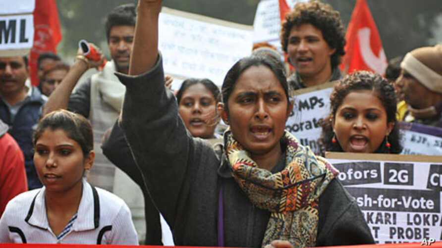 Activists of the communist Party of India (Marxist-Leninist) Liberation (CPIML) shout anti-government slogans during a protest in New Delhi, December 29, 2011.