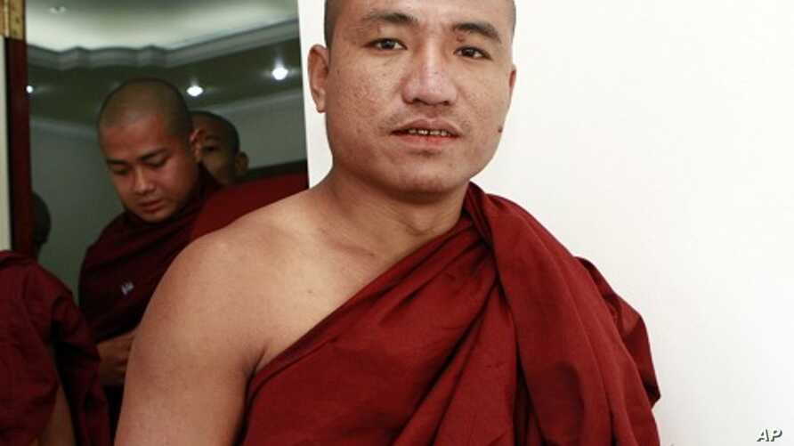 Shin Gambira, 32, a monk who helped lead protests, detained and recently released, attends a ceremony of 'Pray for Peace and Religious Unity' at a church in Yangon, Burma, January 16, 2012.