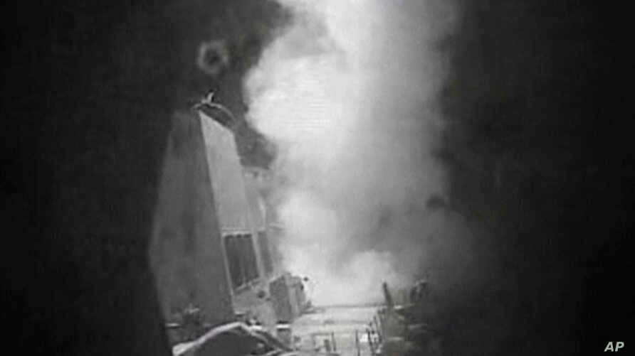 This frame grab of video provided by the United States Navy shows moments after a U.S.-launched Tomahawk cruise missile hits a coastal radar site in Houthi-controlled territory on Yemen's Red Sea Coast, Oct. 13, 2016.