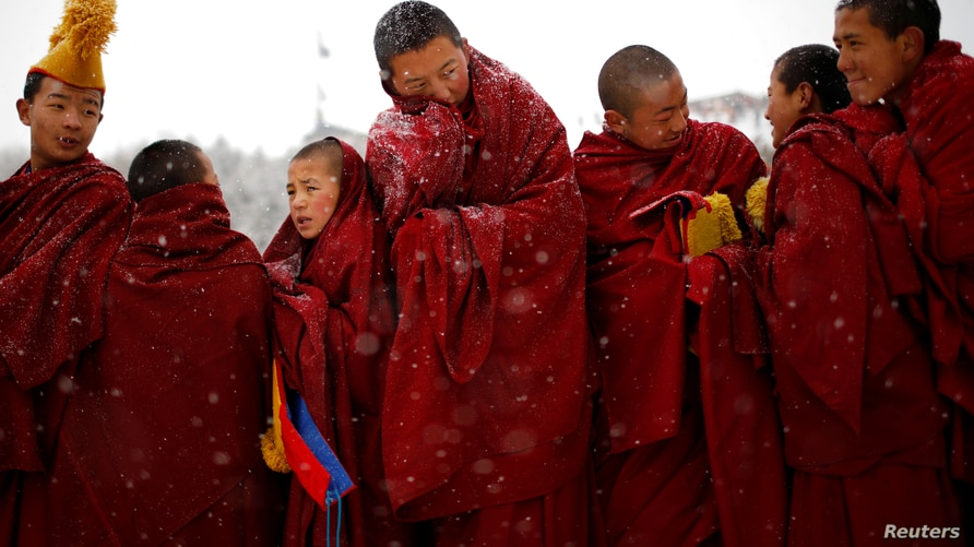 """Tibetan monks attend a ceremony at the Langmu Lamasery during the """"Sunbathing Buddha Festival"""", in Gannan Tibetan Autonomous Prefecture, Gansu Province, China, February 17, 2019."""