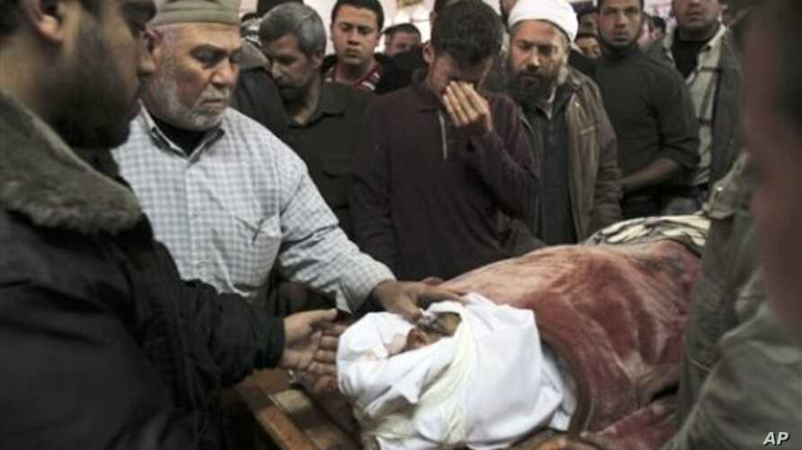 Palestinian relatives gather around the body of a Hamas militant killed in an Israeli air strike on a Hamas training camp, during his funeral in a mosque in Gaza City, March 16, 2011