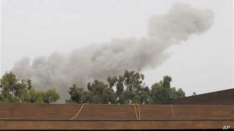 A smoke plume rises into the sky over Tripoli, Libya, on  June 7, 2011 following an airstrike