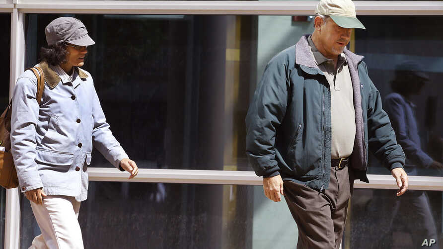 Ana and John Conley, parents of defendant Shannon Conley, exit the U.S. Federal courthouse following their daughter's plea hearing, at the U.S. Federal Courthouse, in Denver, Sept. 10, 2014.
