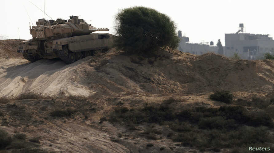 An Israeli tank patrols just outside the border with the northern Gaza Strip October 24, 2012.