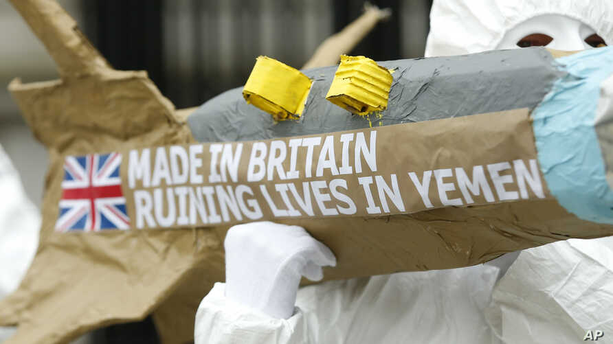 FILE - Amnesty International members protest by carrying a mock up of a missile, against the British Governments continued sale of arms to Saudi Arabia outside Downing Street in London, Friday, March,18, 2016.