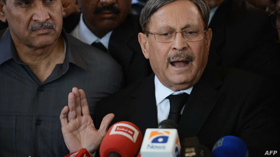 Pakistani Law Minister Farooq H Naik talks with media representatives after appearing at the Supreme Court in Islamabad, October 5, 2012.