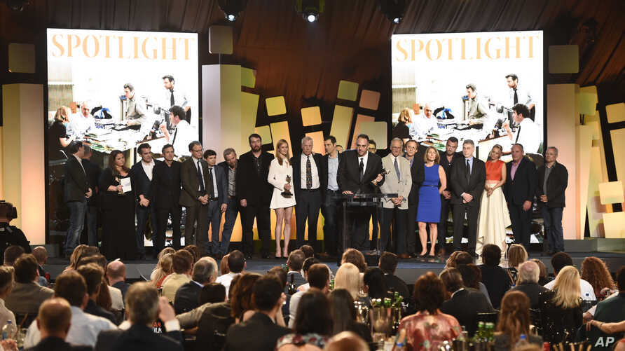 """Michael Sugar, center, and the cast and crew of """"Spotlight"""" accept the award for best feature at the Film Independent Spirit Awards, Feb. 27, 2016, in Santa Monica, California."""