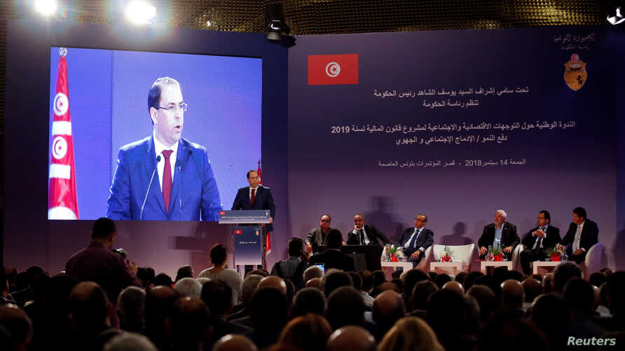 FILE - Tunisia's Prime Minister Youssef Chahed speaks during a national conference on the country's 2019 budget in Tunis, Tunisia, Sept. 14, 2018.