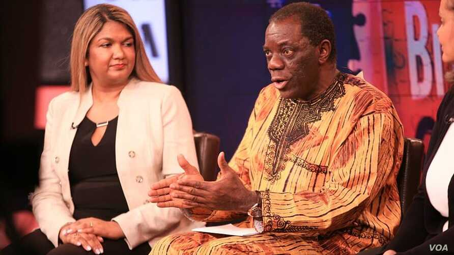 """Usifo Edward Asikhia, a Nigerian physician, talks about autism challenges during a special edition of """"Straight Talk Africa."""" Looking on is Susan Daniels of the U.S. National Institute of Mental Health."""
