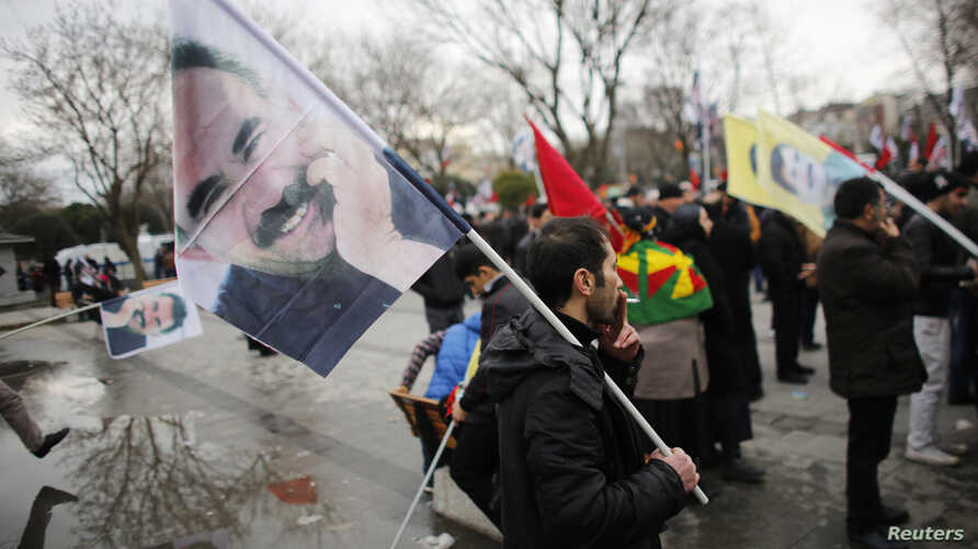 Demonstrators wave flags with the image of imprisoned Kurdish rebel leader Abdullah Ocalan during a rally in Istanbul, Feb. 15, 2015.