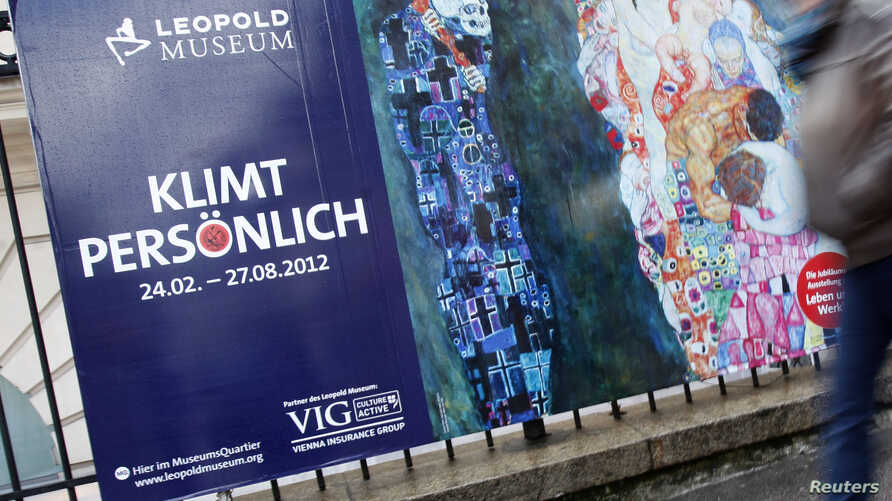 People pass posters advertising exhibitions of painter Gustav Klimt in central Vienna, March 30, 2012. A long-missing Klimt painting, Two Reclining Figures, has resurfaced after being lost for decades.