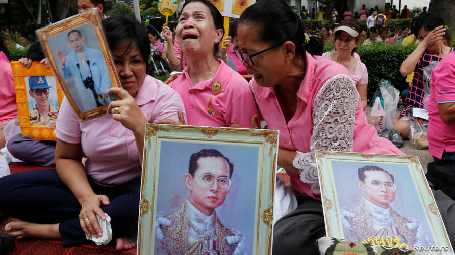 Well-wishers weep as they pray for Thailand's King Bhumibol Adulyadej at the Siriraj hospital where he is residing in Bangkok, Thailand, Oct. 13, 2016.