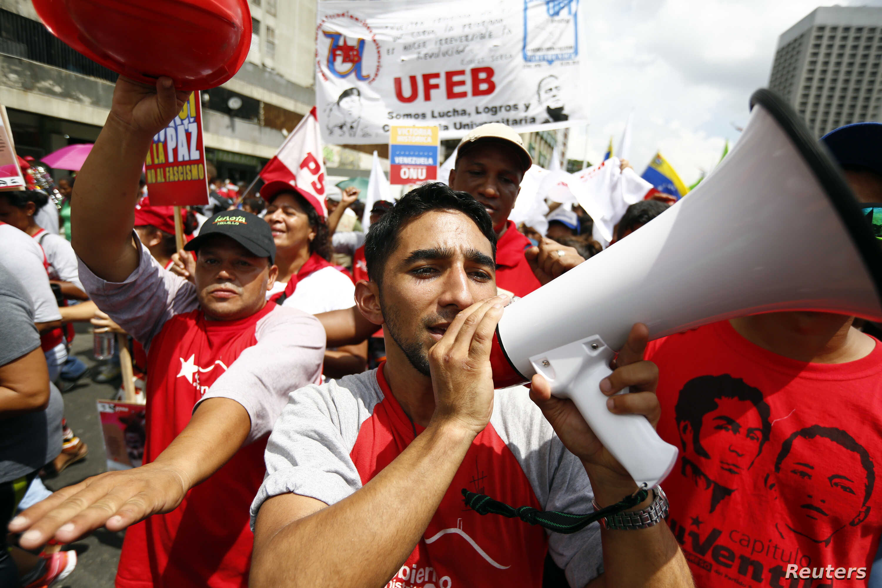 FILE - Supporters of Venezuela's President Nicolas Maduro take part in a rally to support him in Caracas, Oct.18, 2014.