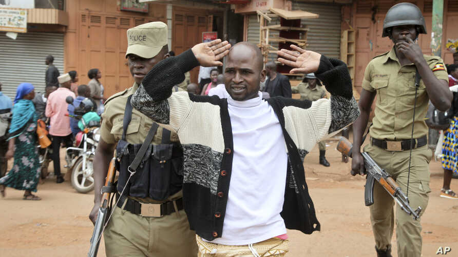 FILE - A supporter of Ugandan pop star-turned-lawmaker Bobi Wine is arrested by security forces during protests in Kampala, Uganda, Aug. 31, 2018.