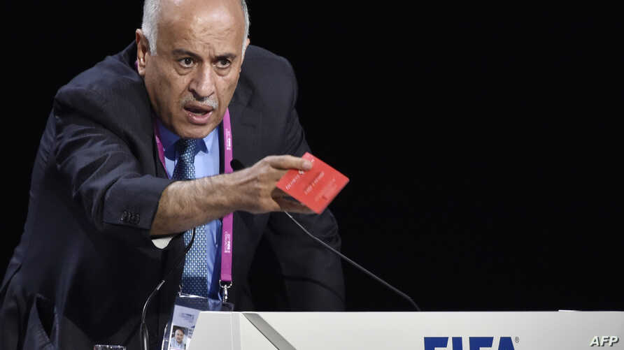 Palestinian football chief Jibril Rajoub shows a red card as he speaks during a FIFA Congress in Zurich, Switzerland, May 29, 2015.