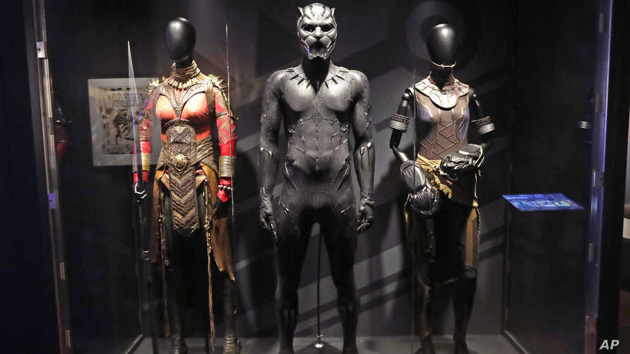 Marvel MoPOP ExhibiIn this photo taken April 18, 2018, costumes worn by Black Panther characters, from left, Okoye, Black Panther and Shuri, are displayed during a preview of the exhibit Marvel: Universe of Super Heroes at the Museum of Pop Culture,