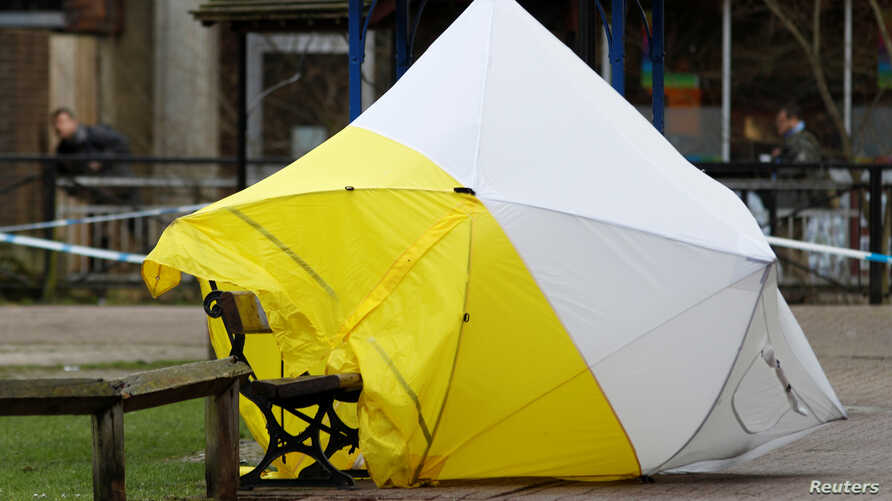 The forensic tent, covering the bench where Sergei Skripal and his daughter Yulia were found, is blown out of position in the centre of Salisbury, Britain, March 8, 2018