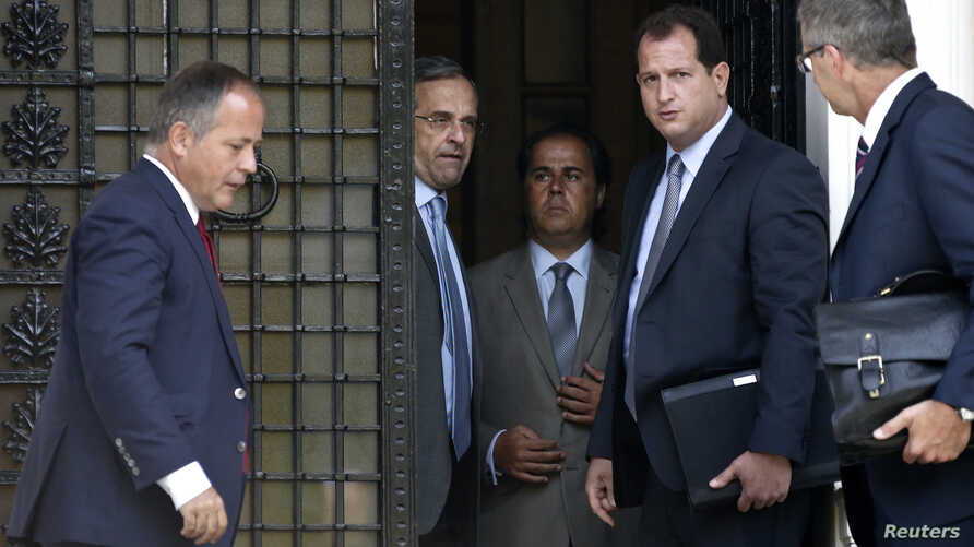 European Central Bank Executive Board member Benoit Coeure (L), Greece's Prime Minister Antonis Samaras (2nd L) and European Central Bank Mission Chief for Greece Klaus Masuch (R) talk after a meeting at the Prime minister's office in Athens, August