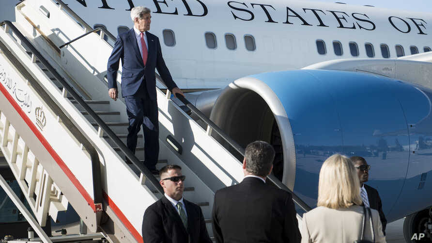 U.S. Secretary of State John Kerry arrives at Queen Alia Airport in Amman, Jordan, Sept. 10, 2014.
